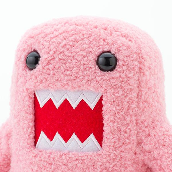 ピンクどーもくんぬいぐるみがセットになった電報です