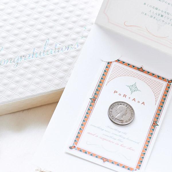 コインの裏面にはヨーロッパの花々のデザイン。
