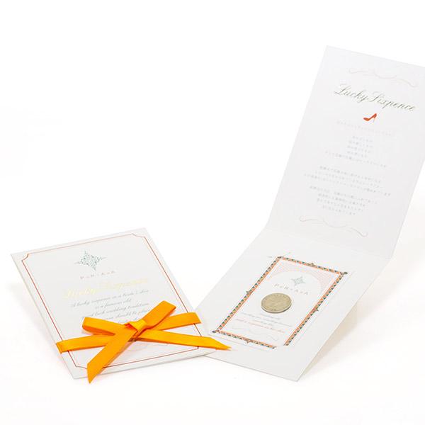 オレンジのリボンつきのカードタイプパッケージ