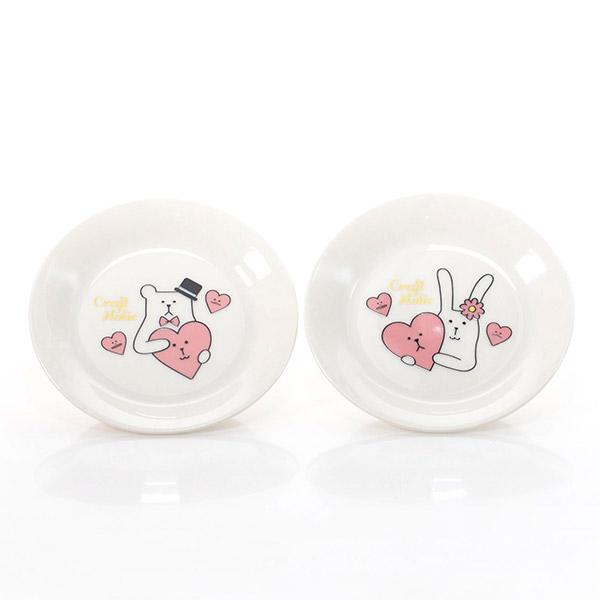 SLOTHとRABのイラストが描かれた小皿