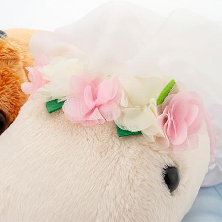 お花がついたふんわりベールを被って。