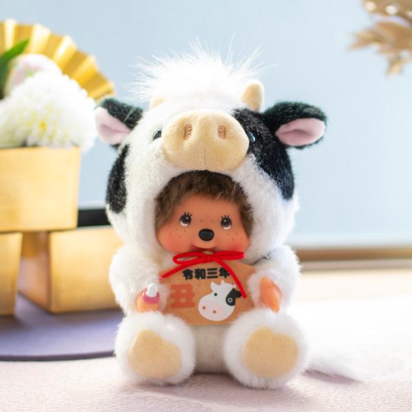 牛の着ぐるみを着たモンチッチ